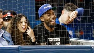 Toronto Raptors basketball player Kawhi Leonard and his girlfriend Kishele Shipley watch the Toronto Blue Jays player the Los Angeles Angels during MLB baseball action in Toronto, Thursday June 20, 2019. THE CANADIAN PRESS/Mark Blinch