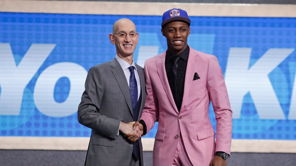 Duke's RJ Barrett, right, poses for photographs with NBA Commissioner Adam Silver after being selected as the third pick overall by the New York Knicks during the NBA basketball draft Thursday, June 20, 2019, in New York. (AP Photo/Julio Cortez)