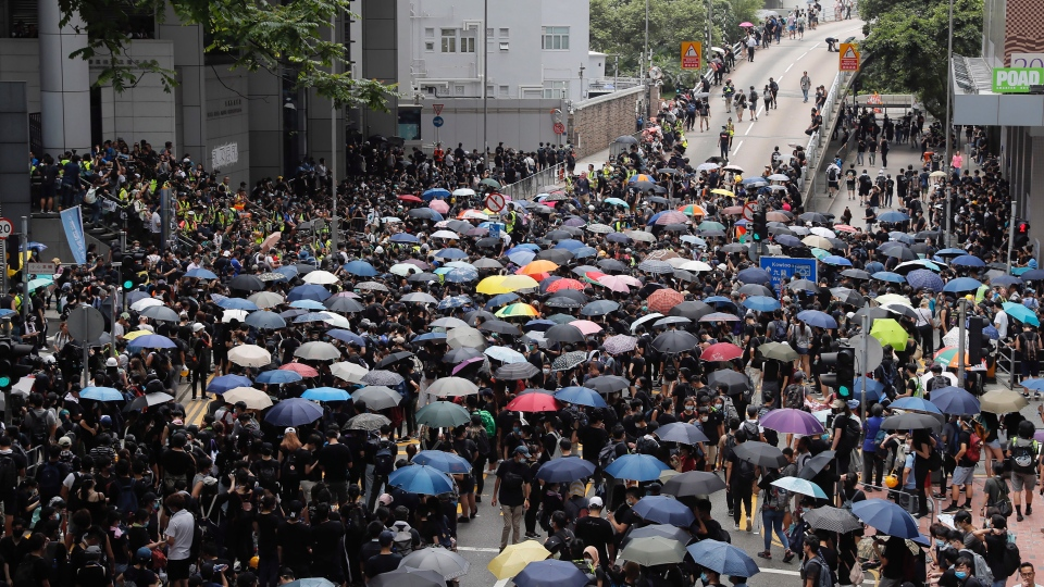 Protestors gather near the police headquarters in Hong Kong on Friday, June 21, 2019. (AP Photo/Kin Cheung)