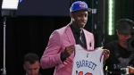 Duke's RJ Barrett shows off a jersey after being selected as the third pick overall by the New York Knicks during the NBA basketball draft Thursday, June 20, 2019, in New York. (AP Photo/Julio Cortez)