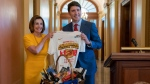 Speaker of the House Nancy Pelosi, D-Calif., and Canadian Prime Minister Justin Trudeau exchange gifts as they settle a wager over the recent NBA basketball championship game between her Golden State Warriors and his victorious Toronto Raptors, at the Capitol in Washington, Thursday, June 20, 2019. (AP Photo/J. Scott Applewhite)