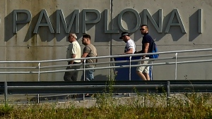 Three of five men granted bail after being acquitted of gang rape leave Pamplona's penitentiary accompanied by unidentified person, left, in Pamplona, northern Spain, Friday, June 22, 2018. (AP Photo/Alvaro Barrientos)