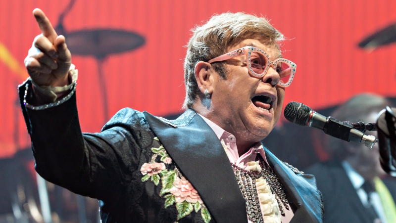Musician Elton John performs on stage during the first of two concerts at the Royal Arena in Copenhagen on his farewell tour 'Farewell Yellow Brick Road Tour', Saturday May 18, 2019. (File Photo/Torben Christensen/Ritzau Scanpix via AP)