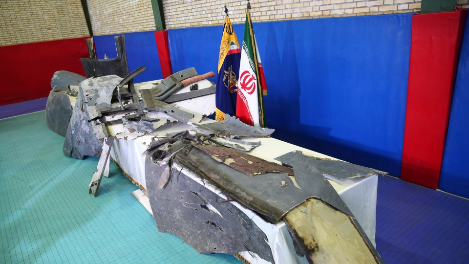 Debris from what Iran's Revolutionary Guard aerospace division describes as the U.S. drone which was shot down on Thursday is displayed in Tehran, Iran, Friday, June 21, 2019.  (Meghdad Madadi/ Tasnim News Agency via AP)