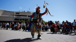 A traditional dance is performed on National Indigenous Peoples Day behind the Canadian Museum of History in Gatineau, Que. on Thursday, June 21, 2018. THE CANADIAN PRESS/David Kawai