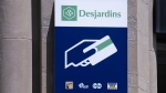 A Caisse populaire Desjardins sign is seen in Montreal on June 18, 2019. (Paul Chiasson / THE CANADIAN PRESS)