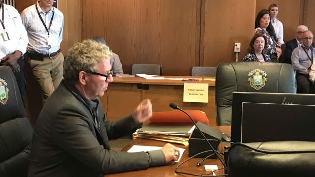 David Asper attends city appeals commitee hearing