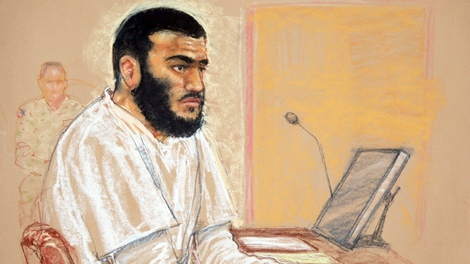 In this photo of a sketch by courtroom artist Janet Hamlin, reviewed by the U.S. Military, Canadian defendant Omar Khadr sits during a hearing at the U.S. Military Commissions court for war crimes, at the U.S. Naval Base, in Guantanamo Bay, Cuba, Monday, Jan. 19, 2009. (AP-Janet Hamlin - THE CANADIAN PRESS)