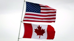 U.S. and Canadian flags fly in Point Roberts, Wash., on Tuesday, March 13, 2012. THE CANADIAN PRESS/Darryl Dyck