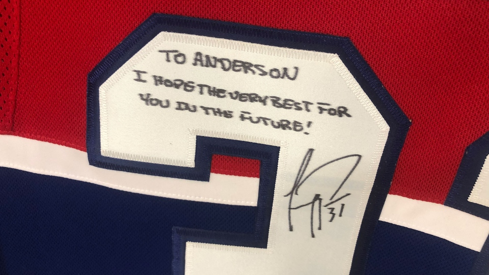 Carey Price's autograph on a jersey he gave to Anderson Whitehead is seen.