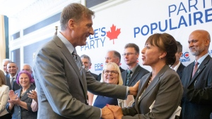 Renata Ford, the former wife of the late Toronto mayor Rob Ford, shakes hands with People's Party of Canada Leader Maxime Bernier as she joins fellow candidates at an announcement in Toronto on Friday, June 21, 2019. THE CANADIAN PRESS/Chris Young