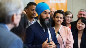 NDP Leader Jagmeet Singh, surrounded by fellow party-members, speaks to the media following a speech at the Ontario NDP Convention in Hamilton, Ont., Sunday, June 16, 2019. THE CANADIAN PRESS/Tara Walton