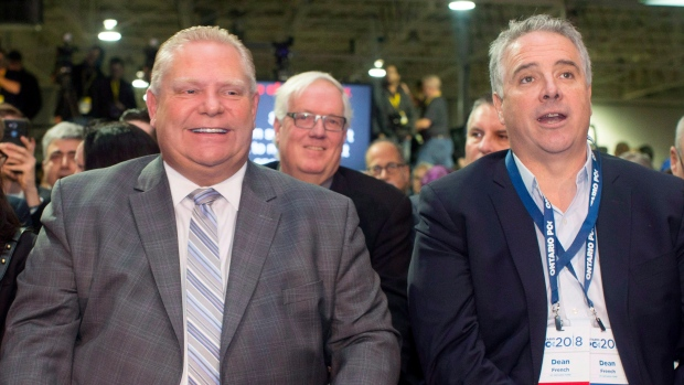 Ontario Premier Doug Ford, centre, sits alongside Chief of Staff Dean French as they prepare to hear Federal Conservative Leader Andrew Scheer speak at the Ontario PC Convention in Toronto on Saturday, November 17, 2018. THE CANADIAN PRESS/Chris Young