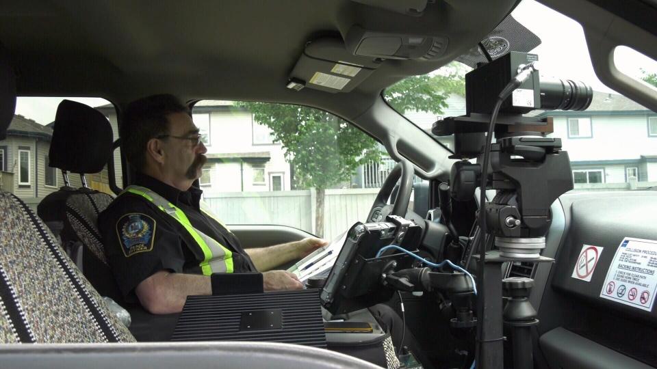 Photo radar operator monitors traffic in a school zone.