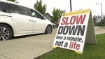 Sign asking drivers to slow down at an Edmonton school.