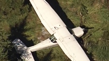 Small plane crash lands in Langley