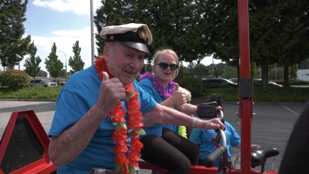 Centenarian celebrating birthday with bike ride