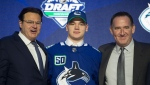 The Vancouver Canucks signed forward Vasily Podkolzin to a three-year entry-level contract on Sunday, May 30, 2021. Podkolzin, centre, is seen here in a 2019 file photo.