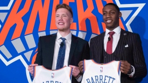 New York Knicks NBA basketball drafts picks Ignas Brazdeikis and RJ Barrett pose for photographers during a news conference, Friday, June 21, 2019, at Madison Square Garden in New York. (AP / Mary Altaffer)