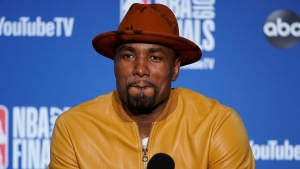 Toronto Raptors center Serge Ibaka speaks at a news conference after Game 4 of basketball's NBA Finals against the Golden State Warriors in Oakland, Calif., Friday, June 7, 2019. (AP Photo/Tony Avelar)