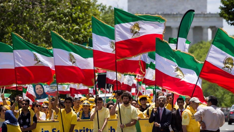 Activists march on 23rd Street, with the Lincoln Memorial behind, en route to the White House to call for regime change in Iran, Friday, June 21, 2019, in Washington. (AP Photo/Alex Brandon)