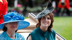 Princess Eugenie, right, looks on as she arrives on the third day of the annual Royal Ascot horse race meeting, which is traditionally known as Ladies Day, in Ascot, England, Thursday June 20, 2019. (AP Photo/Alastair Grant)
