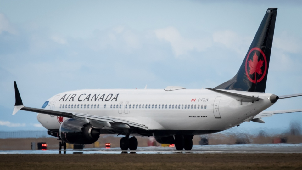 An Air Canada plane is seen in this March 12, 2019 file photo. (THE CANADIAN PRESS/Darryl Dyck)