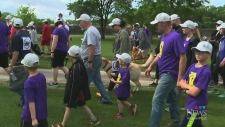 Family walking for young boy with brain tumour