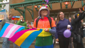 12-year-old Morgan Pearson taking in her first pride parade in Saskatoon after coming out as gender fluid.