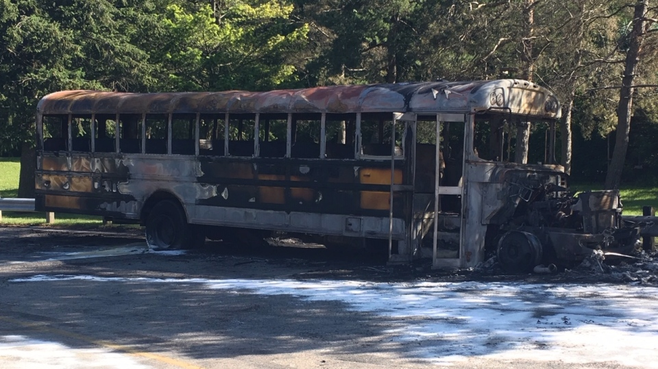 A school bus fire caused loud noise at a high school in London, Ont. early Sunday, June 23, 2019. (Brent Lale / CTV London)