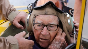 In this June 14, 2019, photo retired Air Force Lt. Col. Bill Willis, 97, gets ready for a flight in a Boeing-Stearman at the Morgan County Airport in Morgan, Utah. (Kristin Murphy/The Deseret News via AP)