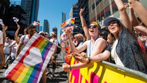 Revelers in the crowd cheer along the route of the 2019 Pride Parade in Toronto, Sunday, June 23, 2019. THE CANADIAN PRESS/Andrew Lahodynskyj