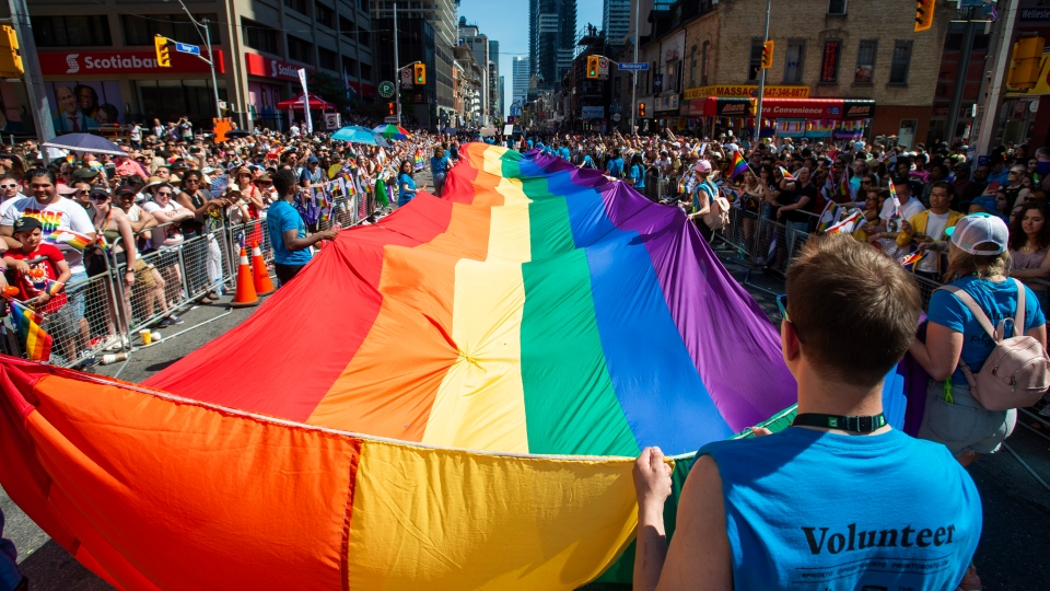 Volunteers with Pride Toronto carry a large rainbow flag during the 2019 Pride Parade in Toronto, Saturday, June 23, 2019. THE CANADIAN PRESS/Andrew Lahodynskyj