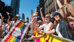 Revelers in the crowd cheer along the route of the 2019 Pride Parade in Toronto, Saturday, June 23, 2019. THE CANADIAN PRESS/Andrew Lahodynskyj