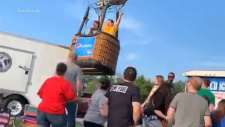 Hot air balloon drops onto crowd of people