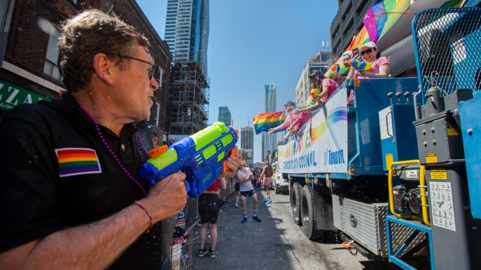 Toronto Mayor John Tory has a water gun fight with participants onboard a Toronto City Council float during the 2019 Pride Parade in Toronto on Sunday, June 23, 2019. THE CANADIAN PRESS/Andrew Lahodynskyj