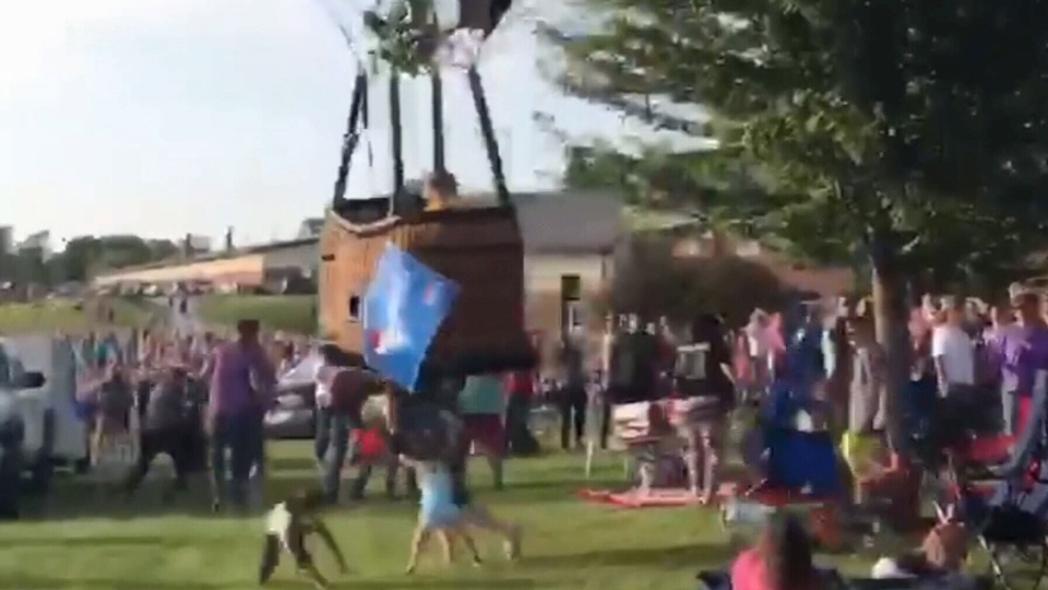 A hot air balloon knocked over at least two people in a crowd at the Hot Air Balloon Festival in Hannibal, Mo., on Saturday, June 22, 2019.