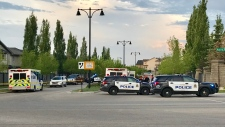 Police block off a portion of Magrath Boulevard Sunday evening.