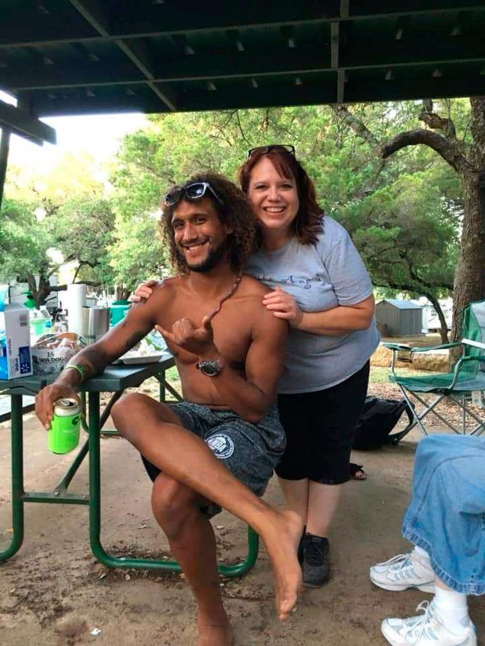 This June 2019 photo provided by Natacha Mendenhall shows Casey Williamson, left, and his mother Carla Ajaga in Possum Kingdom Lake, Texas. (Natacha Mendenhall via AP)