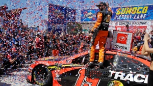 Martin Truex Jr. celebrates after winning a NASCAR Sprint Cup Series auto race Sunday, June 23, 2019, in Sonoma, Calif. (AP Photo/Ben Margot)