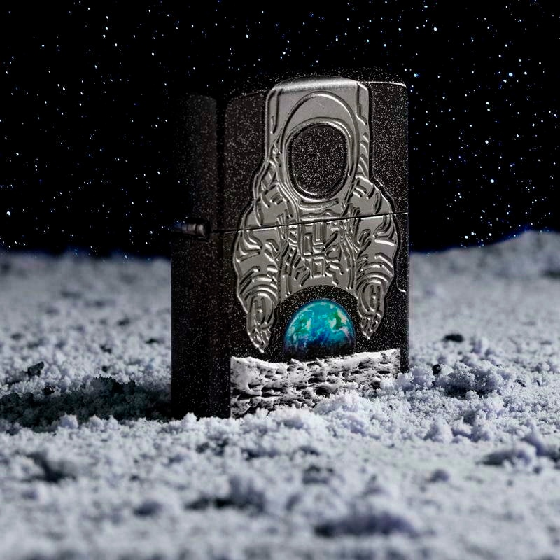 This photo provided by Zippo in June 2019 shows a limited edition lighter released in tribute to the 50th anniversary of the Apollo 11 moon landing. The company has sold out of the 14,000 limited edition lighters. (Zippo via AP)