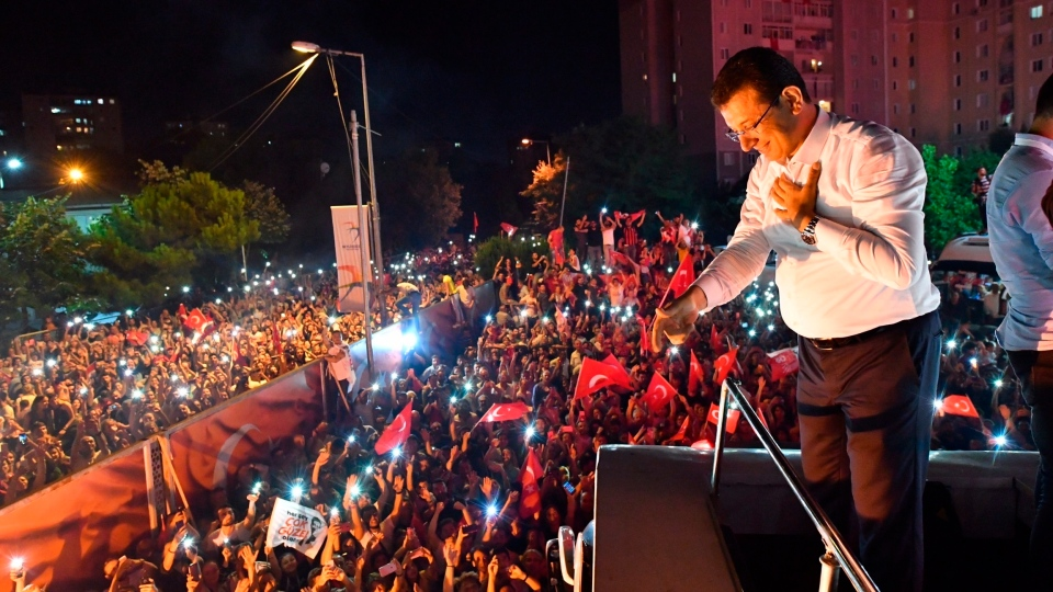 Ekrem Imamoglu, the candidate of the secular opposition Republican People's Party, CHP, talks to supporters from atop his campaign bus during a celebratory rally in Istanbul, late Sunday, June 23, 2019.  (Onur Gunay/Imamoglu Media team via AP)