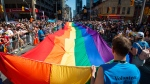 Volunteers with Pride Toronto carry a large rainbow flag during the 2019 Pride Parade in Toronto, Sunday, June 23, 2019. THE CANADIAN PRESS/Andrew Lahodynskyj
