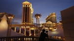 A man takes pictures of Caesars Palace hotel and casino in Las Vegas, on Jan. 12, 2015. (John Locher / AP)