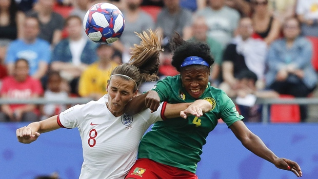 England and Cameroon in action