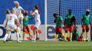 England's Steph Houghton, third from left, celebrates with teammates after scoring her side's first goal during the Women's World Cup round of 16 soccer match between England and Cameroon at the Stade du Hainaut stadium in Valenciennes, France, Sunday, June 23, 2019. (AP Photo/Michel Spingler)