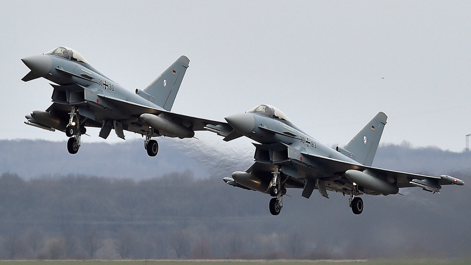 FILE - In this March 21, 2016 file photo, two Eurofighter jets perform at the German Air Force Base in Noervenich, western Germany. (AP Photo/Martin Meissner)