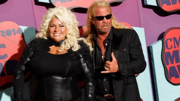 FILE - In this June 4, 2014 file photo, Beth Chapman, left, and Duane Chapman arrive at the CMT Music Awards at Bridgestone Arena, in Nashville, Tenn.  (Photo by Wade Payne/Invision/AP, File)