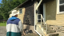 Resident Richard Clark assesses the damage after a fire at his home in Fredericton on June 24, 2019. (Jessica Ng/CTV Atlantic)