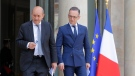 French Foreign Minister Jean-Yves Le Drian, left, and his German counterpart Heiko Maas arrives for a media conference after the cabinet meeting at the Elysee Palace in Paris, France, Wednesday, June 19, 2019.(AP Photo/Michel Euler)
